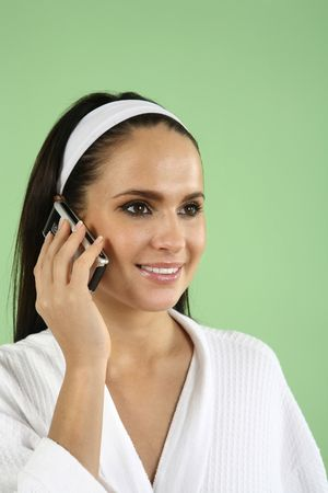 Woman in bathrobe talking on the mobile phone Stock Photo - 2966543