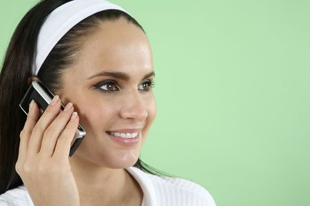 Woman in bathrobe talking on the mobile phone Stock Photo - 2966545