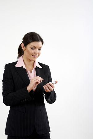 Businesswoman using PDA phone photo
