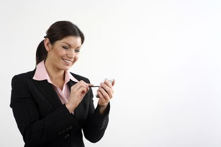 Businesswoman smiling while using PDA phone Stock Photo - 3196046