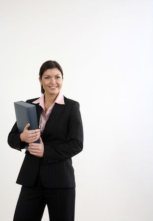 Businesswoman smiling while holding file photo