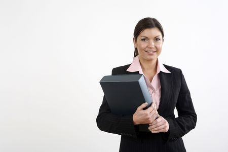 Businesswoman smiling while holding file Stock Photo