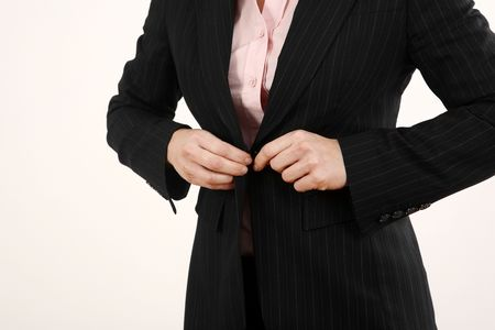 blazer: Businesswoman buttoning her blazer