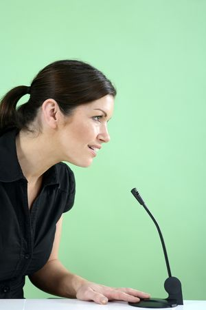 Businesswoman talking into microphone Stock Photo - 3198959