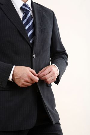 Businessman buttoning his coat Stock Photo - 3198987