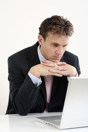 Businessman staring at the laptop photo