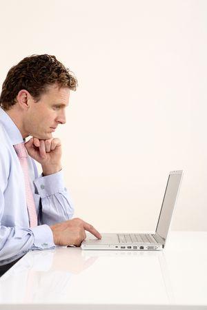 Businessman using laptop photo