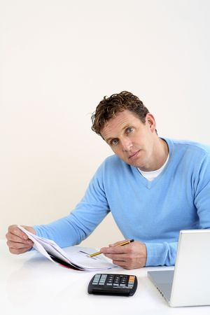 Man holding pen and paper