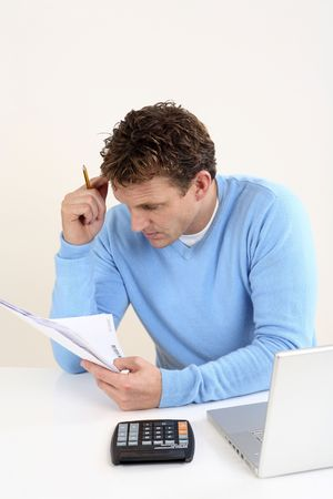 Man reading some documents photo