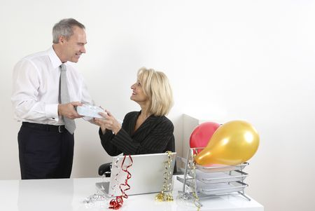 Businesswoman receiving gift from businessman photo