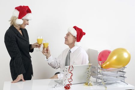 Businessman and businesswoman toasting drinks photo