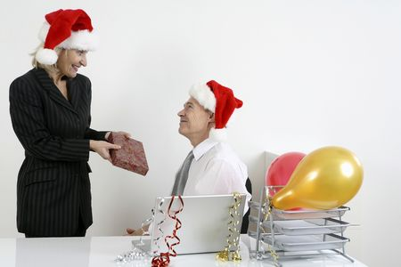Businesswoman giving businessman christmas gift photo