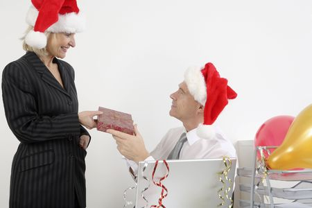 Businessman receiving gift from businesswoman photo