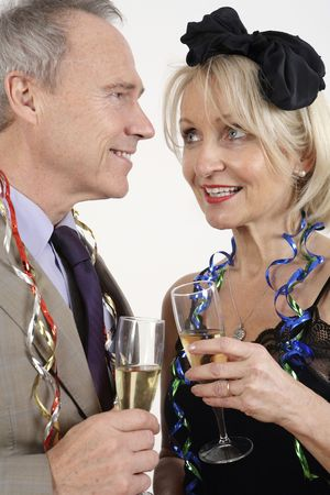 Man and woman chatting while enjoying their drinks photo