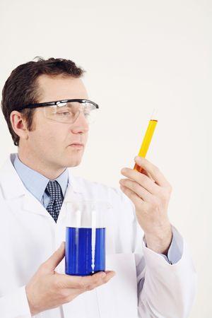 Man examining test tube and beaker photo