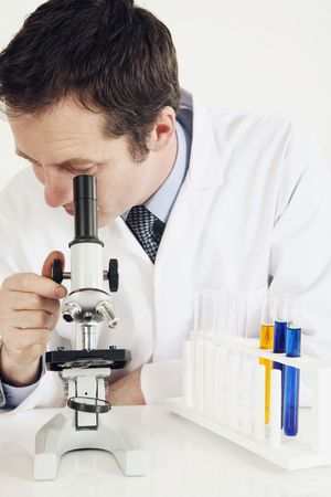 Man using microscope photo