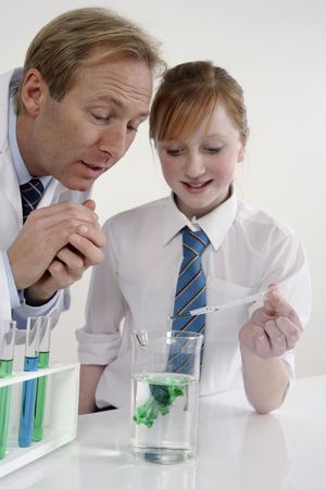 Man and girl in a laboratory carrying out a science experiment Stock Photo - 3205582