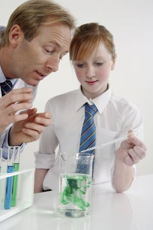 test tube holder: Man and girl in a laboratory carrying out a science experiment