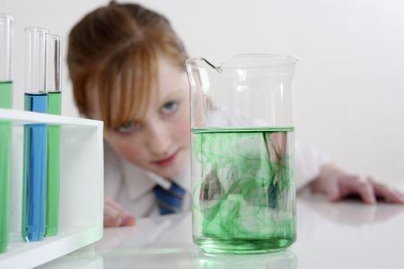 Girl observing liquid in a beaker Stock Photo - 3205523