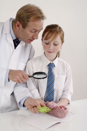 Man giving explanation to girl in a laboratory photo