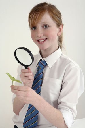 Girl using magnifying glass photo