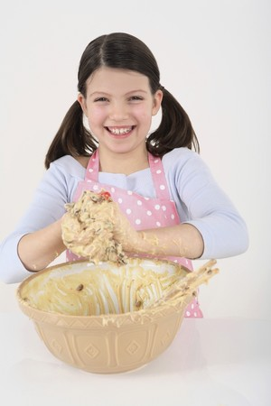 english ethnicity: Girl playing with batter Stock Photo