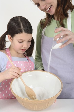 Woman mixing sugar with butter, girl helping Stock Photo - 4107587