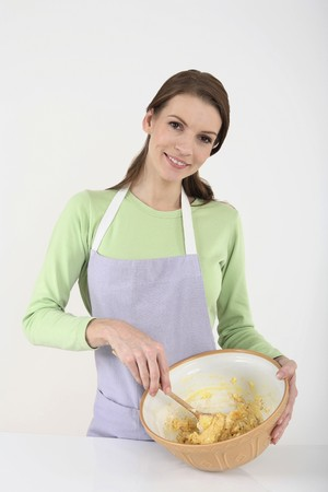 Woman mixing batter in the bowl