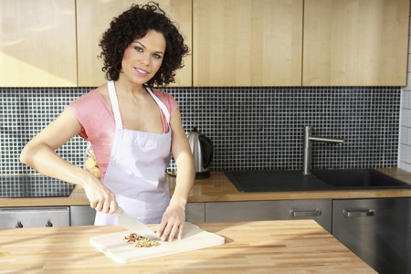 kitchen apron: Woman cutting walnuts