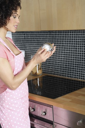 Woman setting the kitchen timer