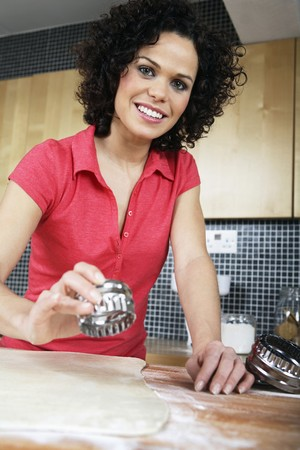 Woman cutting dough with pastry cutter Stock Photo - 4107561