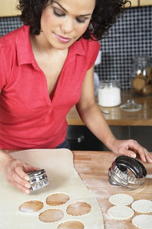 pastry cutter: Woman cutting out dough with pastry cutter Stock Photo