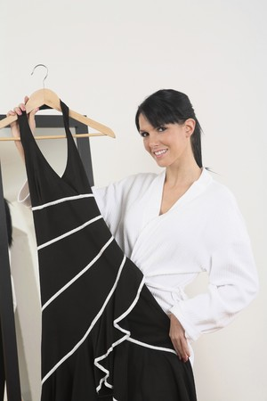 Woman holding a dress and smiling photo