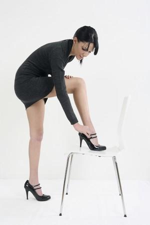 Woman adjusting strap on shoe Stock Photo - 4107313