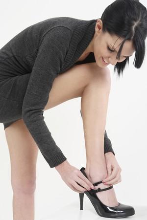 Woman adjusting strap on shoe Stock Photo - 4107558