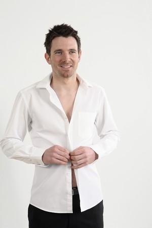 実業家は彼のシャツのボタン 写真素材
