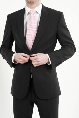Businessman buttoning his coat Stock Photo