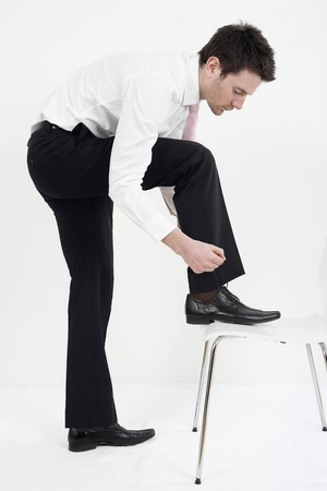 shoelace: Businessman tying shoelace Stock Photo