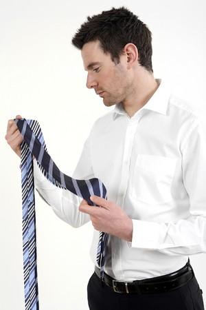 Businessman choosing necktie photo