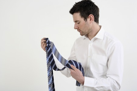 Businessman choosing necktie Stock Photo - 4099507