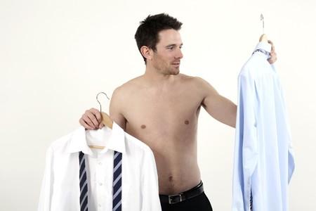 Businessman choosing shirt Stock Photo - 4099093