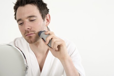 Man in bathrobe shaving