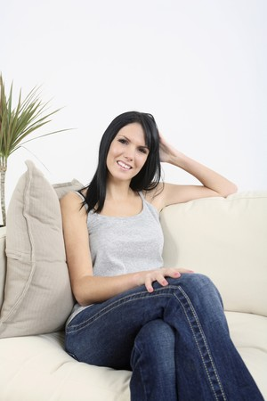 english ethnicity: Woman posing on the couch, smiling