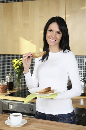 Woman holding toast with butter Stock Photo - 4099690