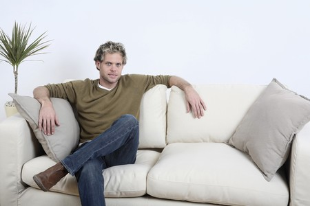 english ethnicity: Man posing on the couch Stock Photo