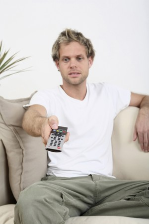 changing channels: Man changing channels with remote control