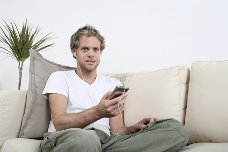 Man listening to music on his MP3 player Stock Photo - 4099848