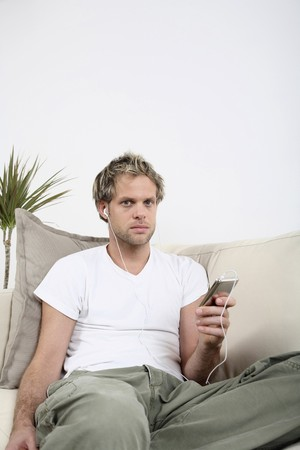 Man listening to music on his MP3 player Stock Photo - 4099622