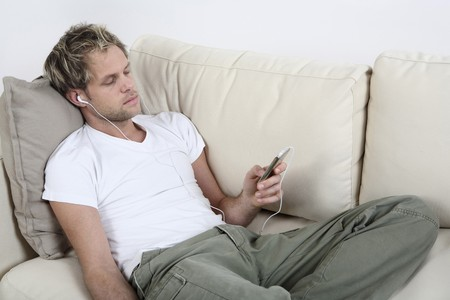 Man listening to music on his MP3 player Stock Photo - 4099963