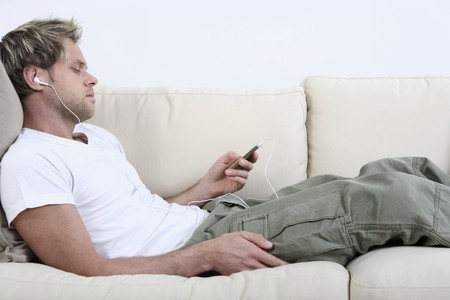 Man listening to music on his MP3 player Stock Photo - 4099695